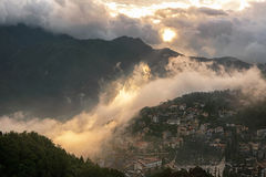 Sapa valley city in the mist at sunset time, Vietnam Royalty Free Stock Photography