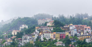 Sapa valley city in the mist, Vietnam Stock Photo