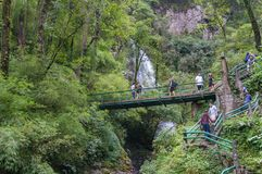 Tourists exploring Love waterfall ecotourism area. Sapa, Vietnam - August 20, 2017: Tourists exploring Love waterfall ecotourism area with beautiful waterfall on Royalty Free Stock Image