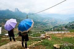 Sapa, Vietnam.- 22. Mai. 2019. Vietnamese hill Tribe look at view over ricefield in lao chai sapa valey in Vietnam. Fogy Landscape of Ricefields in lao chai sapa stock photo