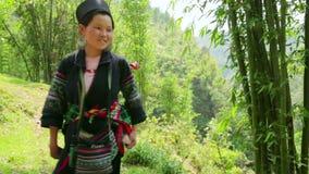 SAPA, VIETNAM - MAY 2014: tribal native Akha woman carry baby stock video