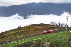 SAPA, VIETNAM: Red cable car to the top of the Fansipan mountain, the highest mountain in Indochina. Red train car in fog high in the mountains above the royalty free stock images