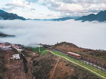 SAPA, VIETNAM: Red cable car to the top of the Fansipan mountain, the highest mountain in Indochina. Red train car in fog high in the mountains above the royalty free stock photos