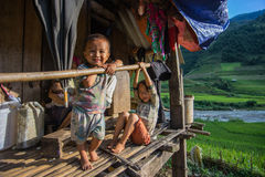 Sapa, Vietnam -14 Sep 2014- A Child sit in fornt of his house in Stock Photos