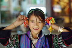 SAPA, VIETNAM - SEP 30:Unidentified cute girl of the flower H'mo. Ng indigenous women at walking street on September 31, 2009 in Sapa, Vietnam. Flower H'mong Stock Photos
