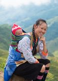 Sapa, Vietnam : Sep 08 2017 : Young mother tribe carrying son baby with smiling and happiness stock photo