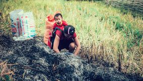 SAPA, Vietnam - 10th September 2016: An unidentified Hmong woman carrying her child in her baby carrier in Northern Vietnam Royalty Free Stock Image