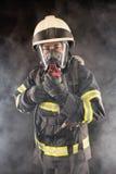 Sapador-bombeiro na engrenagem protetora Imagens de Stock Royalty Free