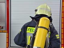 sapador-bombeiro no trabalho Imagem de Stock
