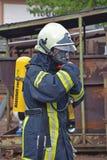 sapador-bombeiro no trabalho Imagens de Stock Royalty Free