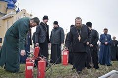 Sapadores-bombeiros e padres Fotografia de Stock