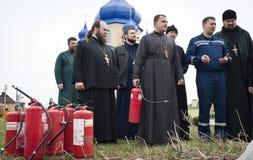 Sapadores-bombeiros e padres Foto de Stock