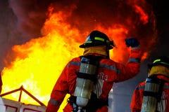 Sapadores-bombeiros na ação Imagens de Stock