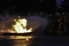 Sapadores-bombeiros no treinamento Foto de Stock Royalty Free