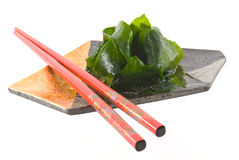 Sapanese plate. Vegetables on a Japanese metal sushi plate, with chopsticks. Isolated on white Royalty Free Stock Photo