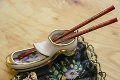 A sapata cerâmica datilografa varas chinesas imagens de stock royalty free