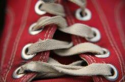 Sapata e laços gastos Fotos de Stock
