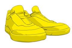 Sapatas amarelas do esporte Fotos de Stock