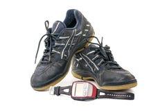 Sapatas cinzentas do esporte com cronômetro Imagem de Stock Royalty Free