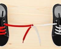 Sapatas com os laços amarrados Fotos de Stock Royalty Free