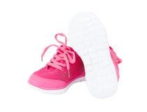 Sapatas cor-de-rosa do treinamento para meninas Imagens de Stock