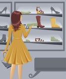 Sapatas da compra da menina Fotografia de Stock