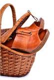 Sapatas da mulher na cesta isolada no branco Imagens de Stock Royalty Free