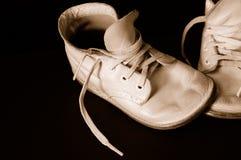 Sapatas de bebê do vintage do Sepia Imagem de Stock Royalty Free