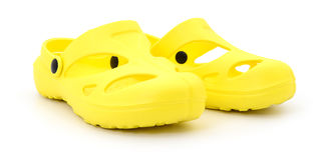 Sapatas de borracha amarelas Imagens de Stock Royalty Free