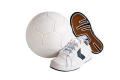 Sapatas de couro e esfera do esporte Foto de Stock Royalty Free