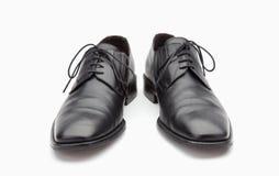Sapatas de couro pretas dos homens Fotografia de Stock Royalty Free