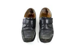 Sapatas de couro pretas usadas e vestidas velhas Imagens de Stock Royalty Free
