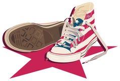 Sapatas de lona e estrela vermelha ilustração do vetor