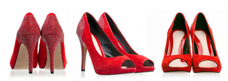 Sapatas de vestido vermelhas sobre o branco Fotos de Stock Royalty Free