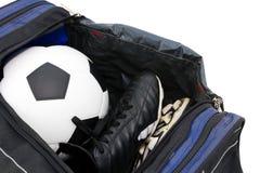 Sapatas do futebol e do futebol Fotografia de Stock Royalty Free
