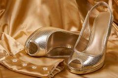 Sapatas douradas Imagem de Stock Royalty Free