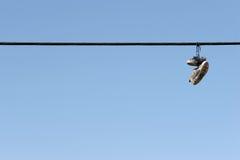 Sapatas em linhas eléctricas Imagem de Stock Royalty Free