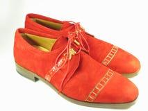 Sapatas vermelhas da camurça Fotografia de Stock Royalty Free