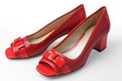 Sapatas vermelhas da mulher Fotos de Stock