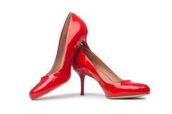 Sapatas vermelhas da mulher isoladas no fundo branco Fotos de Stock Royalty Free