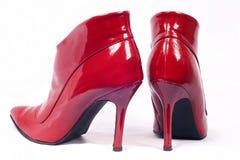 Sapatas vermelhas das mulheres Fotografia de Stock