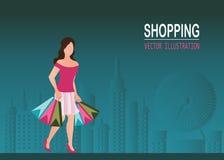 Sapatas vestindo do salto alto da mulher da compra e saco de compras levando Foto de Stock Royalty Free