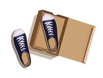 Sapatilhas azuis em uma caixa de cartão ilustração do vetor
