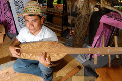 The Sapeh or Sape. The sapeh (sampet, sampeh, sape) is a traditional lute of many of the Orang Ulu or upriver people, who live in the longhouses that line the Stock Photo