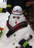 Sapeur-pompier de bonhomme de neige. Qianmen Dajie, Pékin, Chine Image libre de droits