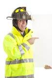 Sapeur-pompier enthousiaste avec le signe photos stock