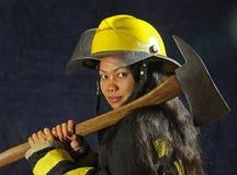 Sapeur-pompier féminin image libre de droits
