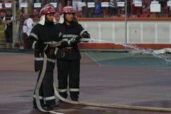 Sapeurs-pompiers dans l'action Photo libre de droits