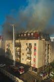 Sapeurs-pompiers dans l'action Photos stock