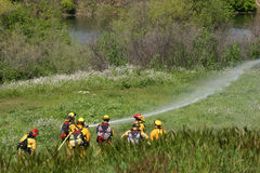 Sapeurs-pompiers dans la formation Photos libres de droits